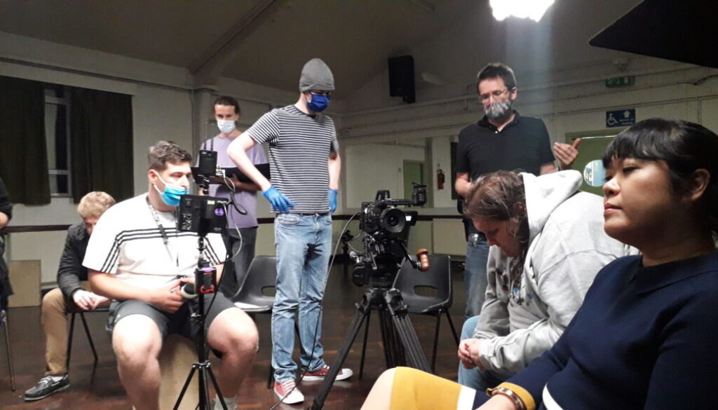 Andrew Curtis sits behind the camera on the set of the film Anonymous while cinematographer Hamish Nichols explains how they will take the shot.